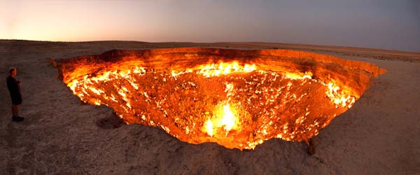 """14.) The """"portal to Hell"""" in Turkmenistan measures 60 meters wide and 20 meters deep. It is a giant gas crater, constantly burning and smelling of sulfur."""