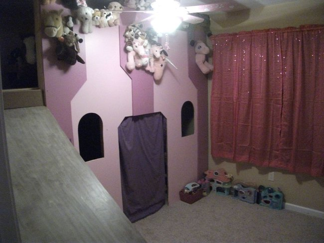 Then the final touches, a blanket as a curtain door and a bunch of stuffed animals.