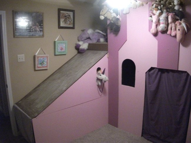"""Here's the finished product. Can't see it very well but her """"secret"""" entrance/exit is at the end of the slide behind another purple blanket door."""