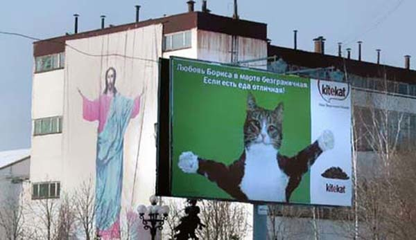 13.) Ah yes. The welcoming arms of Jesus... and his cat.