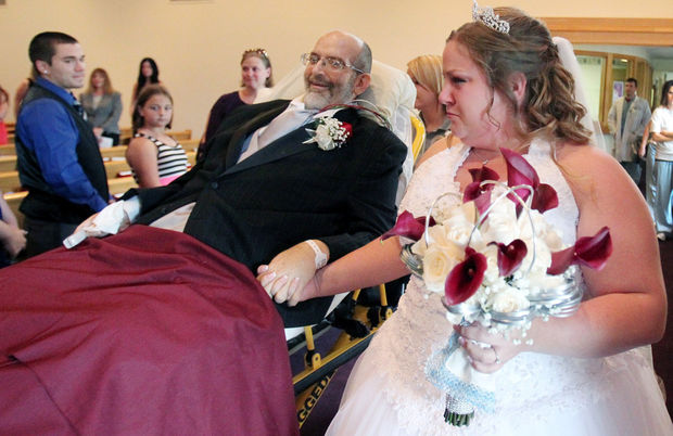 He was confined to a bed while he did it, but he kept his promise to his 24 year-old daughter.