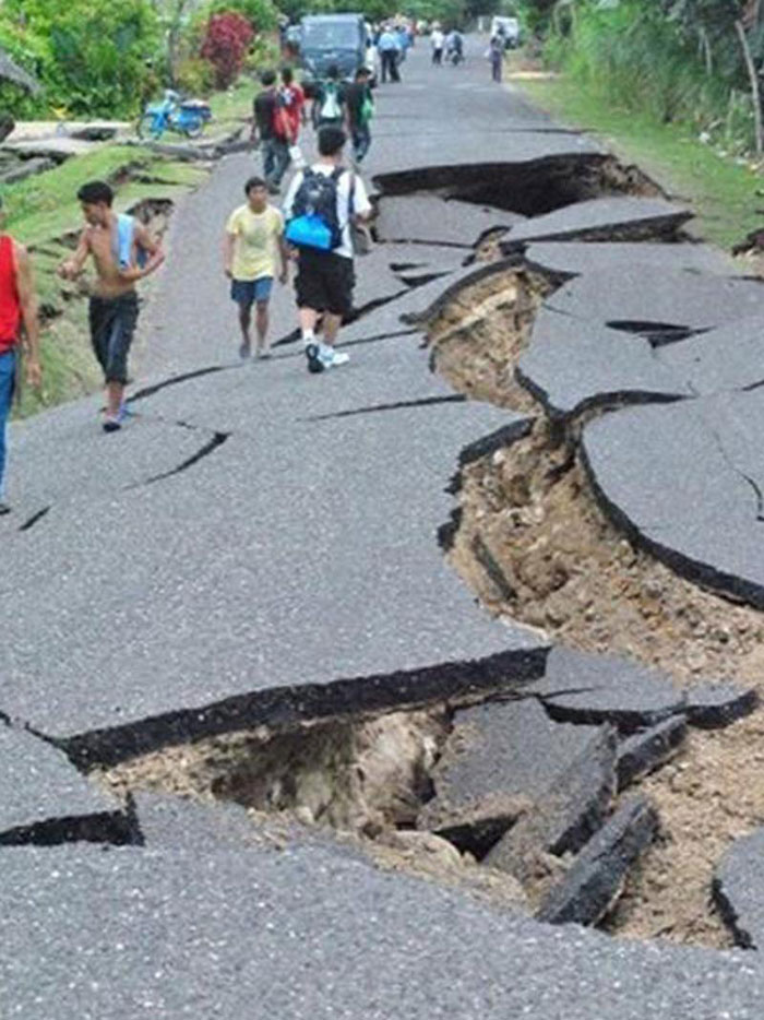 13) Huge crack in a highway after a 6.9-magnitude earthquake hit Negros and Cebu, 2012 (Philippines)