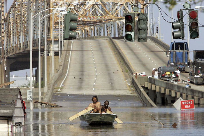 9) Two men get around in a boat in New Orleans following Hurricane Katrina, 2005 (US)