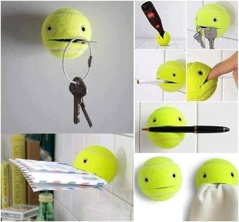 14. Glue a suction cup to a tennis ball and cut a strip in it. Now, that ball will hold anything for you.