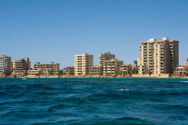 4.) Varosha (Cyprus): Varosha is a completely uninhabited resort city on Cyprus' coast. After the Turkish invasion, Varosha was quickly evacuated. Today, Varosha stands frozen displaying exactly how life was in 1974. From a distance it looks like a bustling resort town, but it is completely dead.