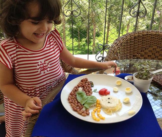 Catarina enjoying her beautiful food.