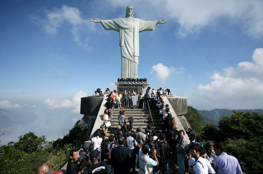 It took the 31-year-old almost half an hour to reach the summit of 124ft-high statue, climbing narrow steps where a single misplaced move would have resulted in serious injury, or worse.