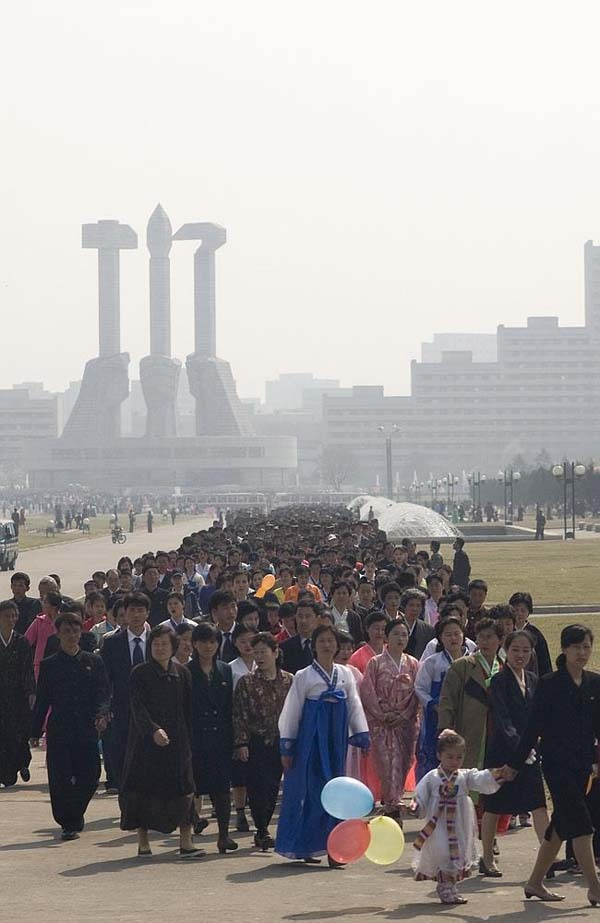 """On the day of the Kimjongilia festival, thousands of North Koreans must queue up to visit various monuments."""