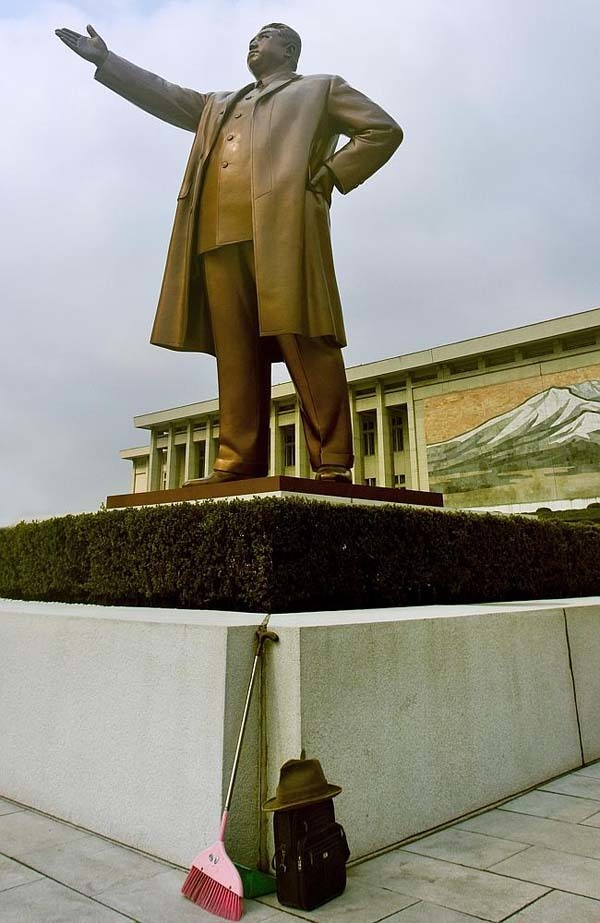 This would be considered a terrible offense: a broom leaning against a statue of Kim Il Sung.