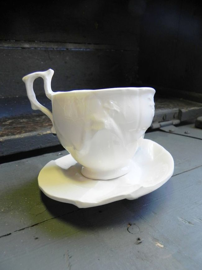 The glassware is then cast with earthenware slip and fired three times in the kiln to complete the body of work.