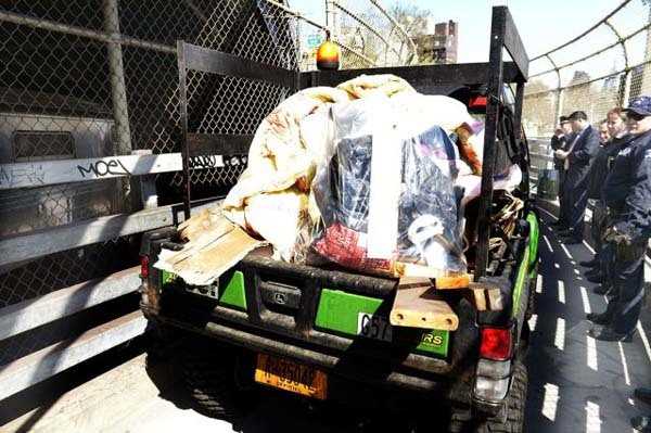 Workers removed a great deal of blankets, necessities and other personal items the homeless people brought with them.