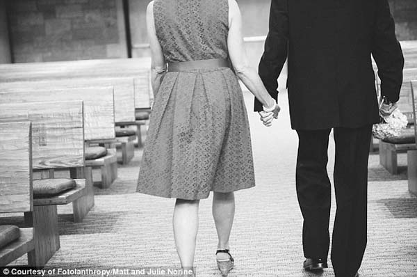 Then, they clasped hands and then walked down the aisle one last time together.