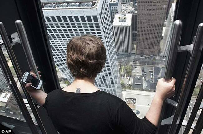 The viewing tilting platform, known aptly as TILT, is located in Chicago's John Hancock Tower.