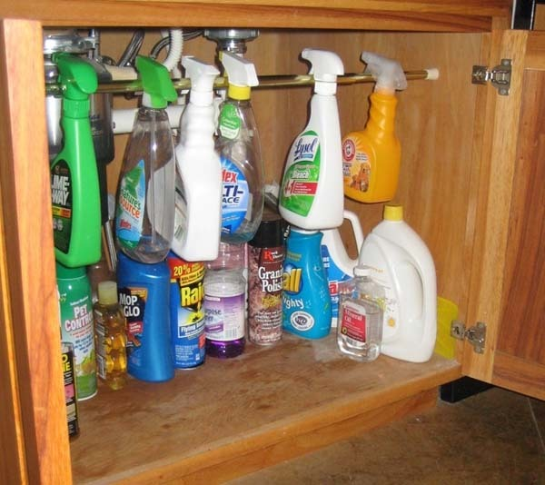 5.) Tension rods can keep cabinets tidy.