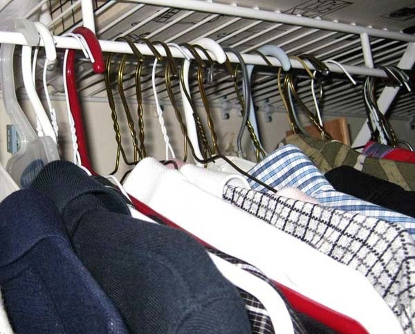 19.) Get rid of clothes you won't wear anymore with the hanger trick. Hang your clothes so that the hangers are backwards. When you use them, put them on the rack the right way. Then you can see what clothes you don't wear.
